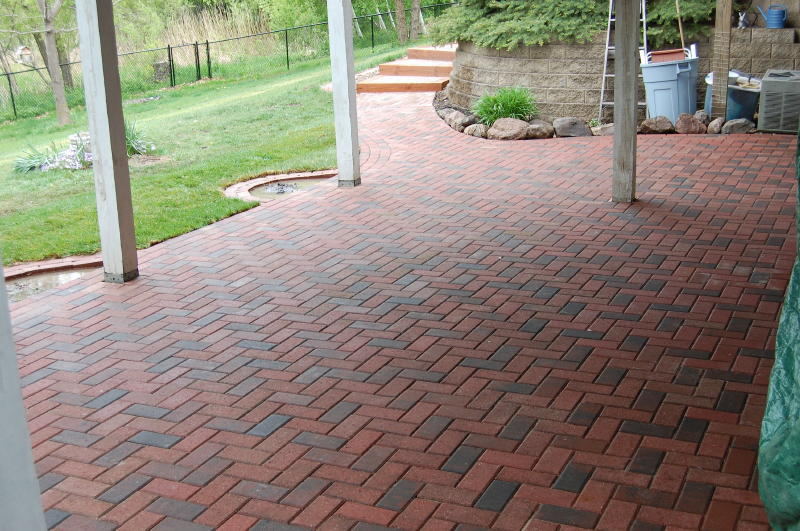 Brickstone pavers installed as herringbone pattern with triple running bond border.