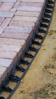 Snap Edge paver restraint used along paver edge.